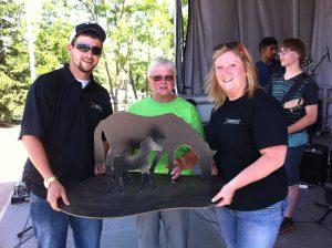 Moffatt Team Members and Metal Sculpture